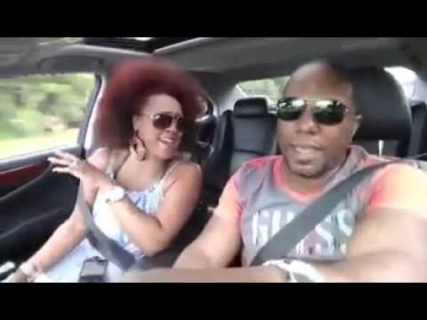 Couple in car singing
