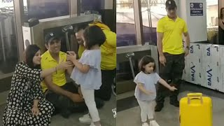After Lossing Match Ms Dhoni and Sakshi waiting for flight and Ziva Playing with box