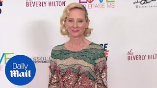 Anne Heche is elegant in a sequin mini dress and nude heels - Daily Mail