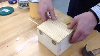 Adding tacks to box lid so the magnets will  hold the lid closed