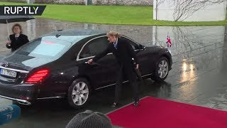 She can't (Br)exit her car either? Theresa May gets locked in vehicle before Merkel meeting