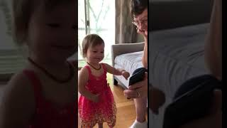 Isla laughing at her own video