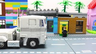 Optimus Prime Transformers Stop motion - Tobot Robot Terracle Car Lego Invisible Bank Robbery Tunnel