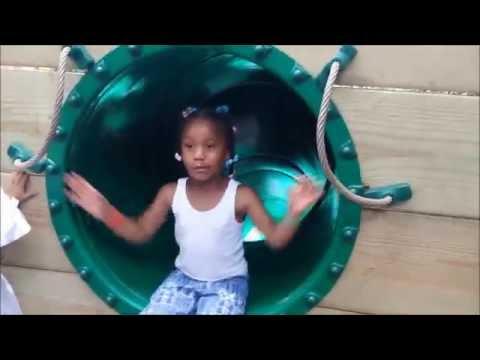 Sassy little girl blocks the slide at the zoo