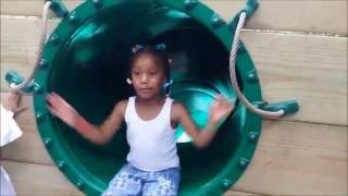 Sassy little girl blocks the slide at the zoo