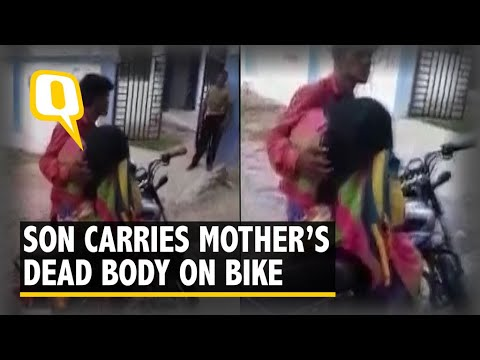 Xxx Mp4 Caught On Cam Son Forced To Carry Mother's Dead Body On A Bike 3gp Sex
