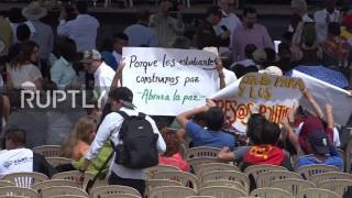 Colombia: 'No more pain and death' – Santos and Timochenko at disarmament ceremony