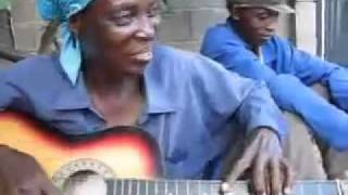 West African Woman Playing The Guitar.flv