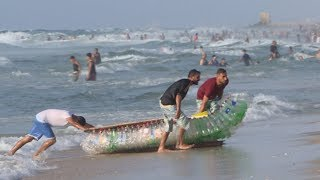 Palestinian fisherman makes boat out of 700 plastic bottles