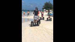 Guests ride on Seven Mile Beach~ Cayman Segway Day Tour