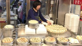 Korea Street Food. Filling 'Mandu' Dumplings at Gwangjan Food Market, Seoul