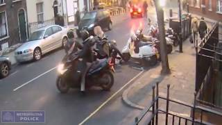 Police release CCTV footage of moped gang stealing scooter in Westminster,London .