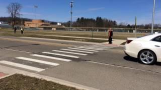 Traffic by Fuller Road crosswalk near Huron High School
