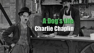 Charlie Chaplin and his brother Sydney in a scene from A Dog
