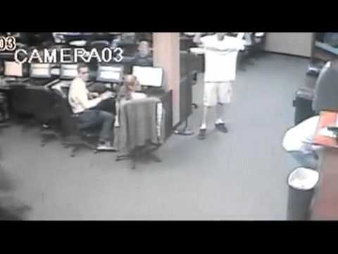 Elderly Man Shoots Robbers at Internet Cafe