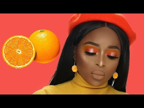 GRWM Orange eyeshadow talk through tutorial for brown skin