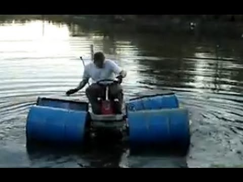 Redneck Jet Ski Lawnmower drives on water