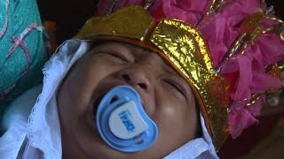 In golden crown, Indonesian girl howls through circumcision