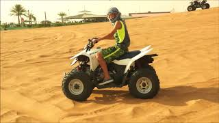 Maxwell rides an ATV (quad) around sand dunes outside Dubai in the UAE, 5 July 2017