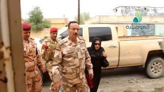 قائد عمليات نينوى يعيد امرأة  مسيحية الى منزلها في حي المهندسين بايسر الموصل