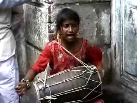 Indian Girl Sings and Plays Drum With Great Heart