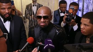 Floyd Mayweather Jr. reacts to Manny Pacquiao vs. Amir Khan becoming official