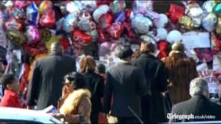 Whitney Houston's coffin arrives in church