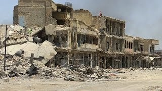 Devastation in Mosul: Iraq Seizes City from ISIS, But Battle Left Thousands Dead & 700,000 Displaced