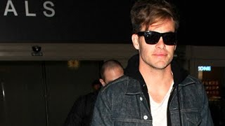 Chris Pine Debuts New Hair Style Arriving At LAX