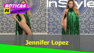 Jennifer Lopez poses nearly in a shimmering emerald gown fory InStyle magazine cover