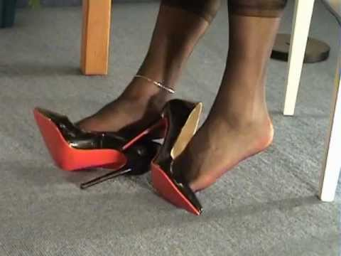 Great shoeplay with black and red high heels