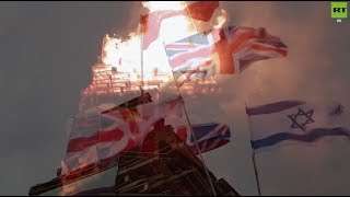 British and Israeli flags set on fire in Derry