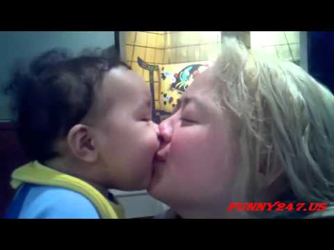 Sweet Baby Kissing a Young Girl