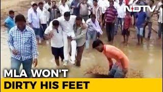 'They Felt Elated': Odisha MLA Carried By Supporters Through Muddy Stretch