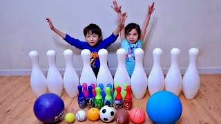 Toddlers Playing and Learning with Bowling Pins and Mini Sports Ball