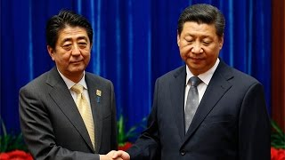 Xi Jinping and Shinzo Abe Share an Awkward Moment at the APEC Summit
