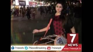 Pakistani girl beating Dhol