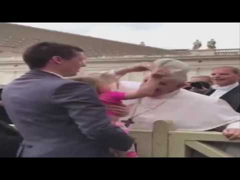 Girl meets Pope. Girl steals his hat