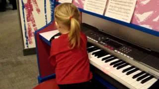 Egie playing music in Elmo's world
