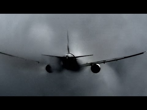 Emirates Boeing 777 making and busting clouds