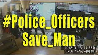 Police officers save man using CPR