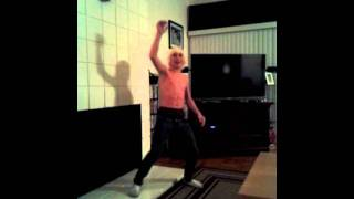 Funny kid dances and moons