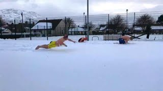 Friends Have Swim Meet in the Snow