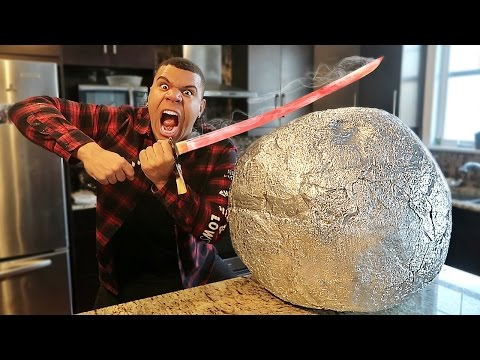 EXPERIMENT Glowing 1000 degree KATANA VS GIANT METAL BALL!