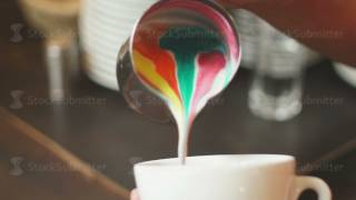 The boiled color milk poured in a cup of espresso. Rainbow latte