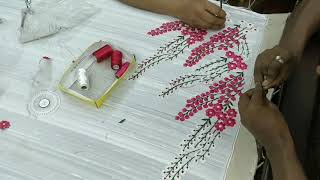 Floral saree being made with embroidery