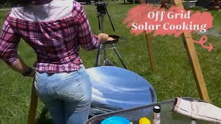 Solar cooking salmon with the sun and citrus salsa parabolic mirror off grid cooking