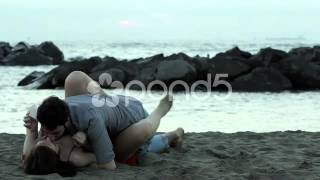 young couple kissing and romance  on the  beach