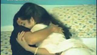 Jayamalini squeezed in bed