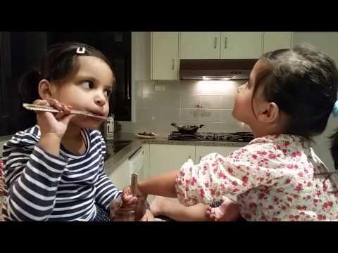 Twin Girls Enjoying Scraping the Nutella Jar Clean
